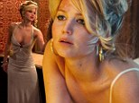 Jennifer Lawrence crawls around in her underwear and takes the plunge in evening gown for sizzling American Hustle film stills
