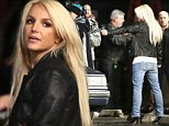 Armed and dangerous! Gun-toting Britney Spears shoots at man in a car as the cameras roll for her new music video