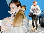 Rumer Willis carries pet pooch under her jumper as she takes her 'babies' to the vets