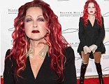Brimstone and Fire! Cyndi Lauper matches lipstick to her fiery hair as she attends charity gala in New York