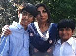 Family drama: Police in upstate New York are looking for Sarwat Lodhi, 43 (center), who they say may be injured, after her two sons Zain, 9, and Mugthba, 13, were found shot dead along with their father