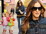 Two cute! Sarah Jessica Parker's twins stand out in bright matching boots and rain coats as she walks them home from school