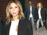 New York, NY - Kanye West and his fianc Kim Kardashian leave their New York apartment in route to Kanye's concert tonigh
