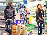 Three's company: Jemima Russell and pet dog Brian seemed entertained in each others company during a petrol station stop in London