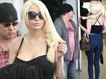 Watching her go? Doug Hutchison struggles not to stare at his soon-to-be ex wife Courtney Stodden the day after she stepped out with Anna Nicole Smith's former love Edward Lozzi