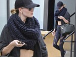 Rosie Huntington-Whiteley manages to look gorgeous after an exercise session as she leaves gym in crop top and cut-out leggings
