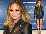 Forever legs! Model Chrissy Teigen struts her lean and long limbs in lacy black mini-skirt to attend fashion launch