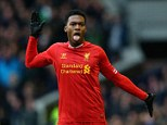 Glove affair: The Liverpool striker celebrates his late equaliser with some impromptu dance moves