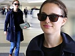 No luggage, no problem: Makeup-free Natalie Portman looks light as a feather as she strolls through an airport with just a clutch purse and a smile