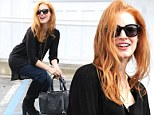 Giggling Jessica Chastain is caught in an awkward squat in public parking lot as she rifles around for missing car keys