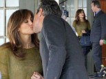 That ought to feel nice! Jennifer Lopez shares a tender kiss with dashing co-star John Corbett on the set of Boy Next Door