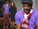 Making a bold statement: Idris Elba wears striped scarf with purple T-shirt and red trousers at Mandela event with Naomie Harris