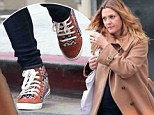 Stylish for supper: Pregnant Drew Barrymore wore a hip pair of sneakers as she grabbed food at The Grill in Beverly Hills, California on Thursday