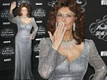 Italian actress Sophia Loren stunned in a dazzling silver dress at the Pirelli 50th anniversary event in Milan