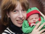 Hammer: Heather Thorpe, pictured last year with weeks-old Jonathan, was filmed hitting her pregnant belly