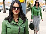 It's easy going green! Olivia Munn shows off her womanly figure as she brings some colour to a grey day in the city