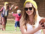 Heavily pregnant Teresa Palmer has a ball with future stepson Isaac in the park