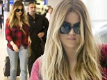 'We need to smile more': Khloe Kardashian fails to follow her own advice as she looks sullen before jetting out of Australia