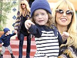 Still pregnant then? Rachel Zoe steps out with son Skyler looking slim despite revealing she's nine months gone