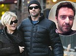 'Relieved' Hugh Jackman and wife Deborra-Lee Furness link arms as they walk in New York following his skin cancer revelation: 'I'm glad we caught it,' he said
