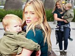 Doting mom Hilary Duff totes her lookalike son on her hip as she enjoys a family breakfast outing in Beverly Hills