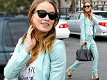 Is it a hint? Pregnant Olivia Wilde drops by a community service center wearing a baby blue suit