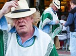 I TOLD you it was him! Nick Nolte gets stopped by fans, despite bizarre poncho and straw hat disguise