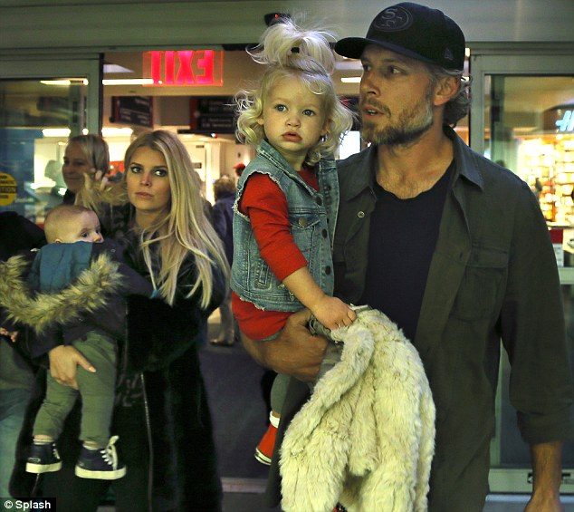Home for the holidays: Jessica Simpson, 33, her husband Eric Johnson and their children Maxwell and Ace touched down in Eric's home city of Boston for the Thanksgiving holidays