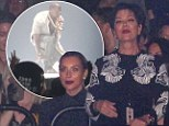 She can't keep up! Kim Kardashian, left, appeared reserved, as her mother Kris Jenner, right, danced the night away as the two watched Kanye West's performance at Madison Square Garden in New York City on Saturday