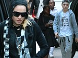 Carrying the keys to the kingdom! Madonna wears bunch of symbolic gold keys around her neck on family trip to Kabbalah center