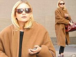 She picked the right career! Designer Ashley Olsen drowns her tiny figure in a brown sack but still manages to look epic