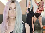Lady And Then Tramp! Ke$ha arrives at AMAs in elegant black gown, then changes into trashy high-leg shorts