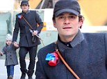 Men about town! Newly single Orlando Bloom and son Flynn look dapper in matching double-breasted coats