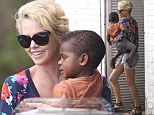 Everything's coming up roses! Charlize Theron cuddles Jackson in floral top while Down Under in Rose Bay