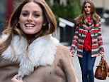 Cosy but chic: Olivia Palermo models new winter styles during a photo shoot in New York City Sunday