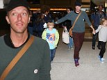 2513020 London calling! Chris Martin and his children jet out from Los Angeles to see Gwyneth Paltrow as she works on latest film