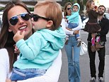 Alessandra Ambrosio flashes her toned midriff, besotted with her cute toddler Noah as he tries on dad Jamie Mazur's sunglasses during family excursion
