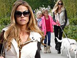 Doggy day out! Denise Richards and two of her daughters take their four-legged furry friend shopping