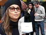 Gina Gershon uses body heat to stay warm during a cosy outdoor lunch with a new mystery man in New York City