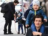 He's a natural! Orlando Bloom teaches his son Flynn the proper way to walk their dog during outing in New York