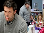 Bubble yum! Ben Affleck plays with his gum while with his girls at sewing shop