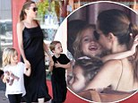 Angelina Jolie showers twins Vivienne and Knox with kisses and cuddles as she takes a break from directing new film in Sydney