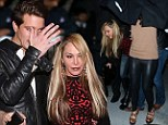 Adrienne Maloof and boy toy Jacob Busch avoid the cameras Saturday as they leave Mastro's Steakhouse