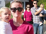 Reese Witherspoon and husband Jim Toth take turns toting tartan-clad Tennessee through Brentwood