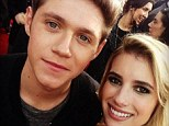 Emma Roberts poses for a selfie with Niall Horan from One Direction at the American Music Awards