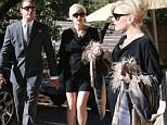 Pregnant rocker Gwen Stefani attends a friend's wedding wearing black fishnets and a short dress