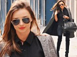 Are they meant for walking? Miranda Kerr turns the streets of New York into a catwalk in some sexy thigh-high boots