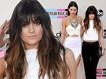 Bang on trend! Kylie Jenner debuts new fringe at American Music Awards while elder sister Kendall raises hemlines in a daring white mini skirt with crop top