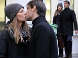All a-Fleury! Hilary Swank shares a kiss with her Saint Laurent in front of flagship store on Paris stroll