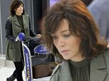 Wild hair: Singer Dannii Minogue shows off her huge hair as she gets off a flight in Melbourne